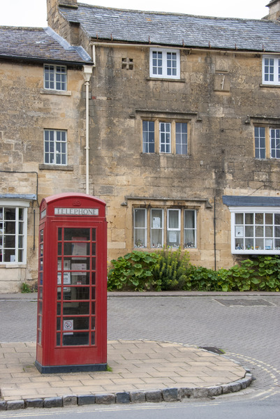 Red English Telephone Box: Red British telephone booth on street corner