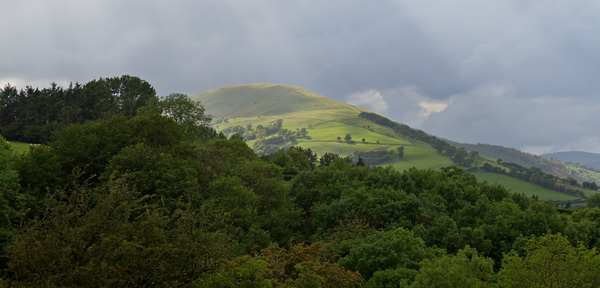 Stormy hill: A hill with an approaching storm in eastern Wales.