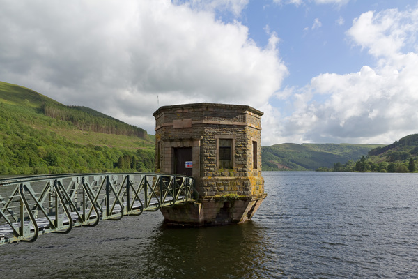 Reservoir control station: Water-flow control station of a reservoir in eastern Wales in late spring.