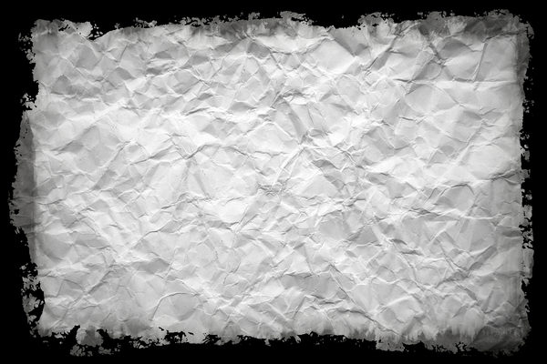 Crumpled Grungy Paper: A background of crumpled paper with a torn edge. You may prefer: http://www.rgbstock.com/photo/mh6rAci/ or http://www.rgbstock.com/photo/o7mbRAK/
