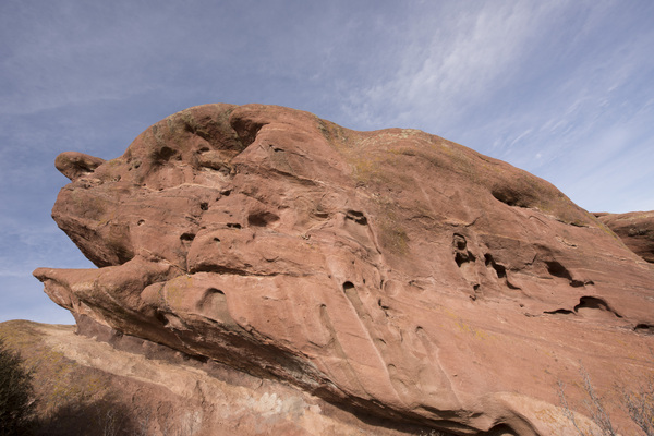 Large Red Rock: Red Rocks Park in Morrison, Colorado, USA, is known for its very large red sandstone outcrops as shown here. I think this looks like the a side profile of a person's face.  Or maybe a big fish.  What do you think?