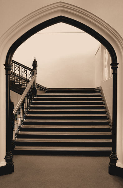 on the way up2: stairway on the other side of the arched entrance in sepia