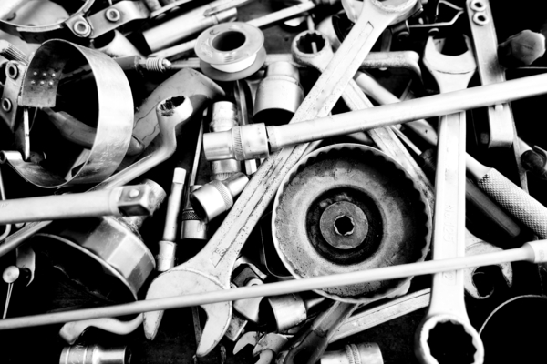 b&w image with car tools: Car tools as found in the toolbox tools set of the mechanics in the car garage. They are made of stainless steel and their metallic shine is very interesting in Black and white photo giving the monochrome one extra shining texture