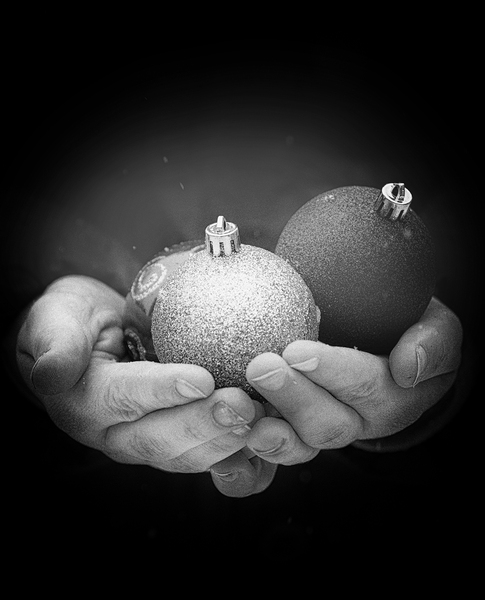 baubles in hands grainy: black and white baubles in hands, grainy iso for a bit of drama :)