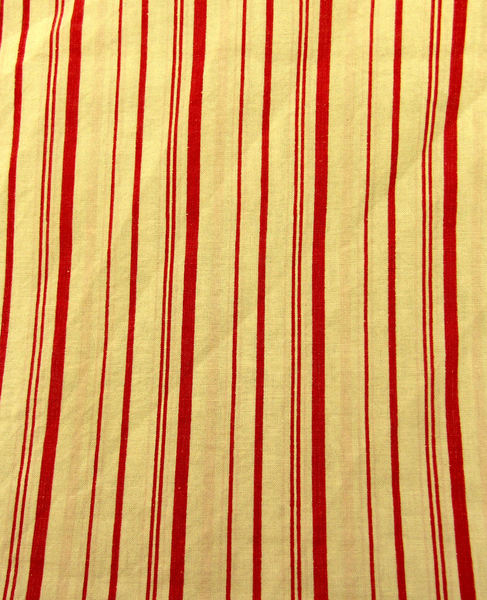 yellow & red striped backgroun: abstract striped coloured fabric background