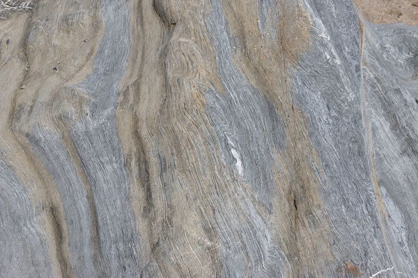 Rock texture: Worn sedimentary rock on the coast of Cornwall, England.