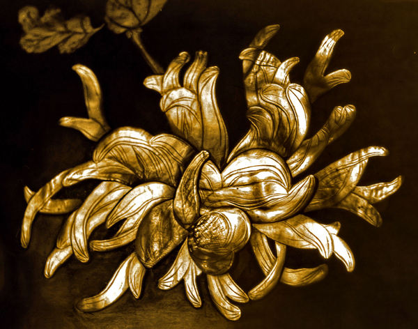golden shell flower: intricately carved vintage ornamental shell flower in sepia image