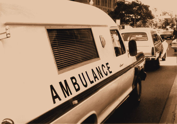 vintage ambulance1.: sepia image of 1950s-60s roadside ambulance