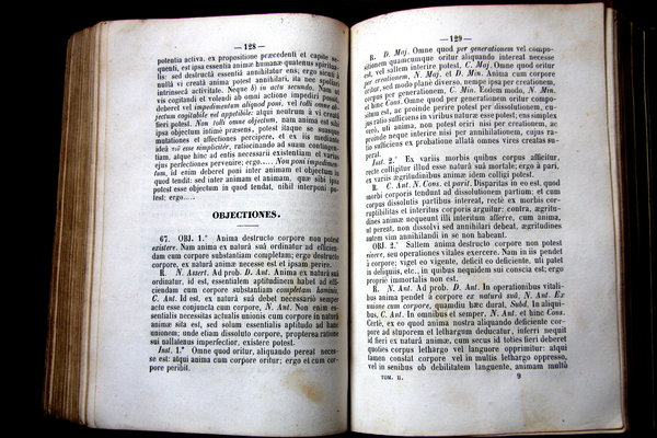 Book pages: A very old books from XVIII century, written in latin and spanish