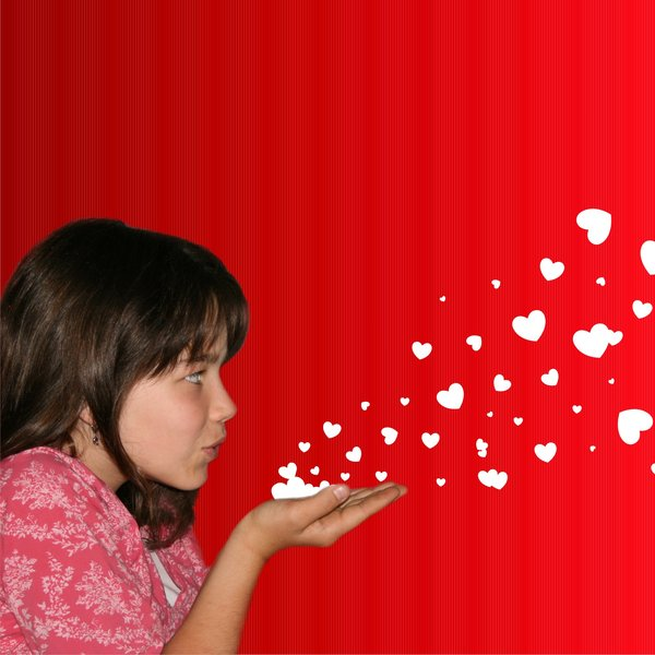 Girl blowing hearts: Girl (my daughter) blowing hearts