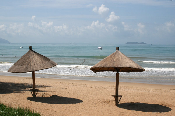 Beach umbrellas: Sun umbrellas on a beach on the southern shore of Hainan Island, China.
