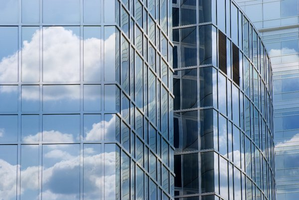 Clouds reflected in corporate : reflected clouds in office windows - larger file available