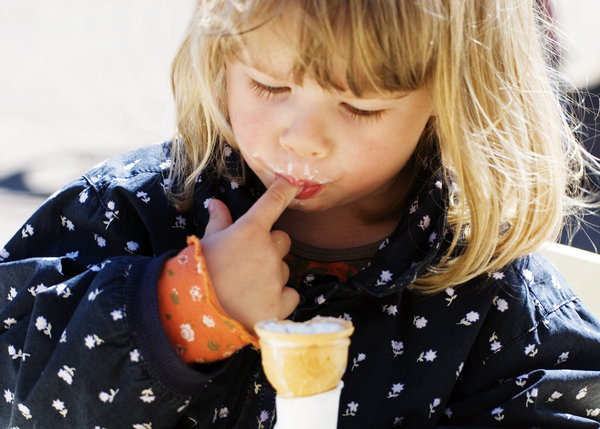 Ice cream: Little girl enjoying an icecream