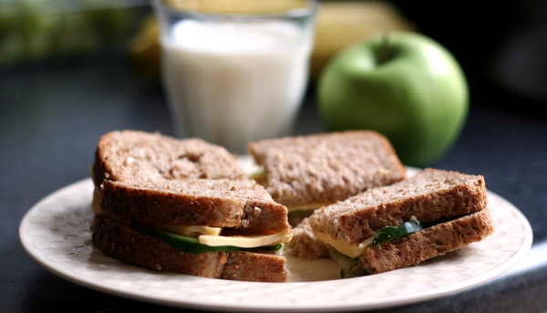 healthy lunch: cheese cucumber sandwich, milk and apple