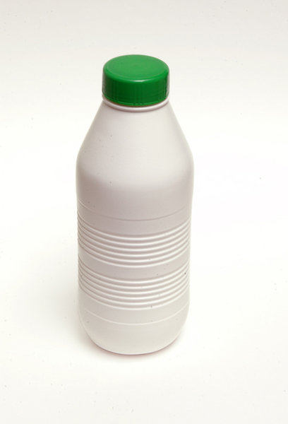 A (pvc) bottle of milk.: A white (pvc) bottle of milk.