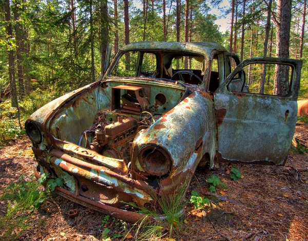 Disintegration - HDR: Old car left in Sweedish forest to disintegrate (in peace). The picture is HDR using five images.