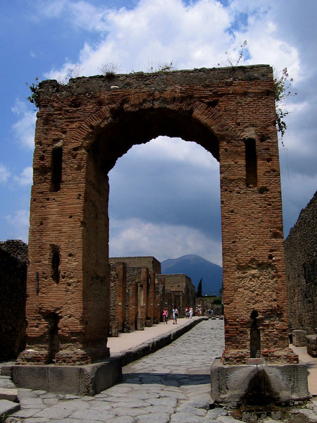 Gate: Gate in Pompeii with the Vesuvius volcano in the background.