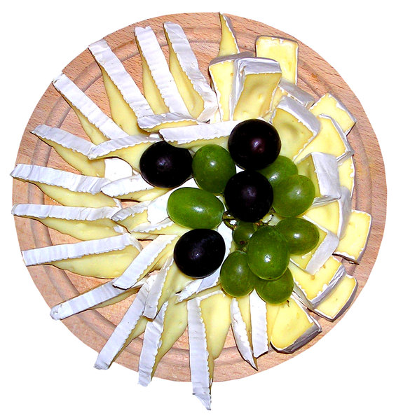 Cheese plate: A cheese on a wooden plate. Camembert is, of course, made from unpasteurized cow's milk. Brie is similar, bud made in different part of France.Please comment this shot or mail me if you found it useful. Just to let me know!I would be extremely happy to se