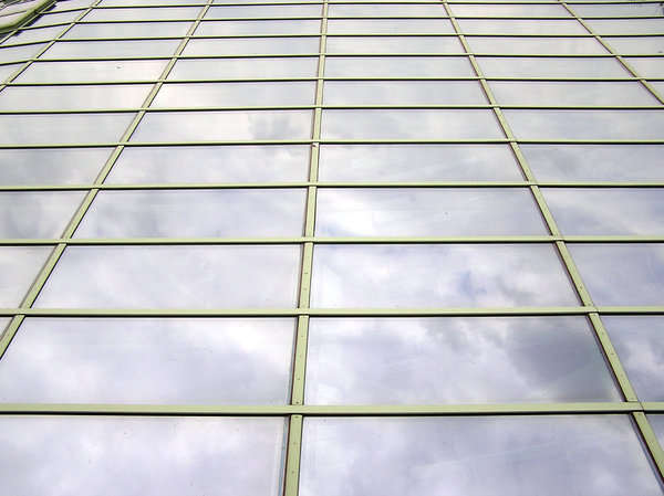 Glass windows: Some glass windows mirroring the clouds.Please comment this shot or mail me if you found it useful. Just to let me know!I would be extremely happy to see the final work even if you think it is nothing special! For me it is (and for my portfolio).