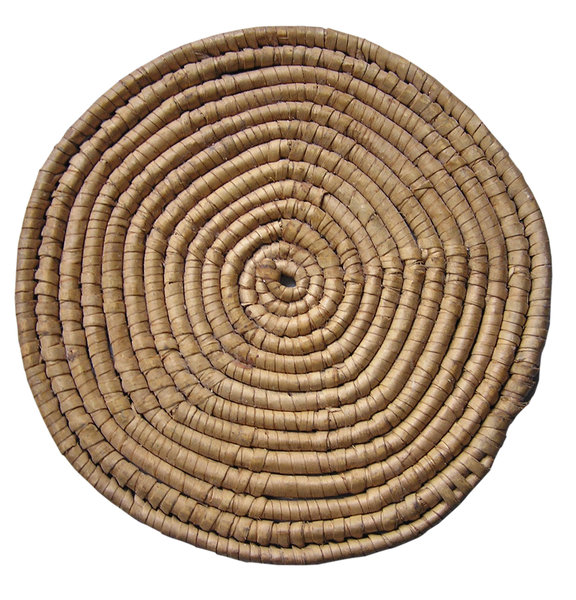 Straw mat: Straw circle mat. Good for hot pots.Please comment this shot or mail me if you found it useful. Just to let me know!I would be extremely happy to see the final work even if you think it is nothing special! For me it is (and for my portfolio).