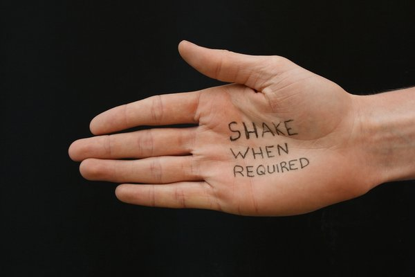 Shake When Required: Outstretched white hand with message, friendship help concept