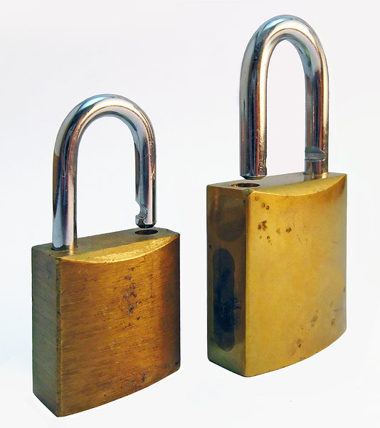 Padlocks: Two padlocks against white background