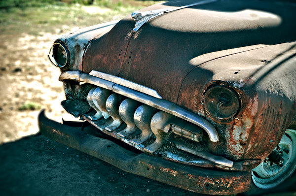 Rusty car: Image of an old, rusty, abandoned car