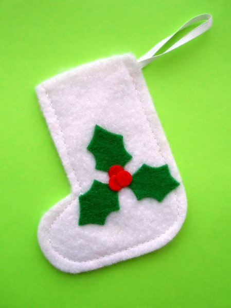 Christmas Stocking: Small white Christmas stocking with a green holly leaf pattern