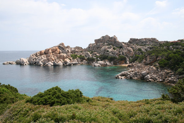 Quiet inlet: Clear aquamarine seawater of a coastal inlet in Sardinia.