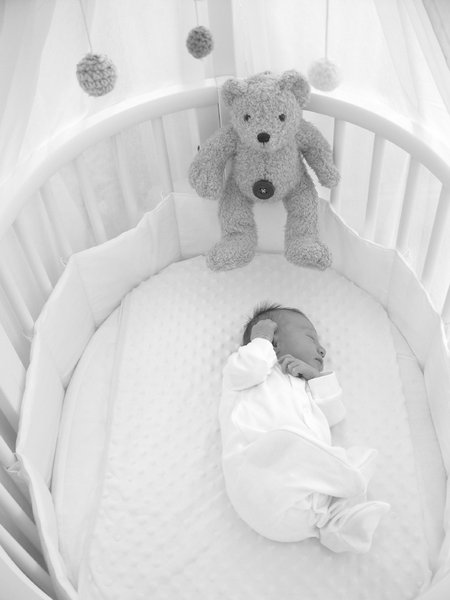 Isabelle Grace in cot: Baby asleep in cot