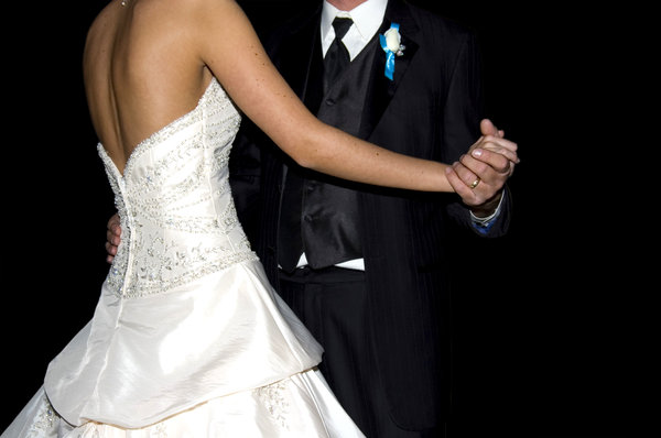 Wedding dance: A photo of my baby brother and his new wife.  He is a Dr. of pathology / Guitarist... she is an accountant/ballerina.  Love you both.  Best wishes Russell and Lauren.