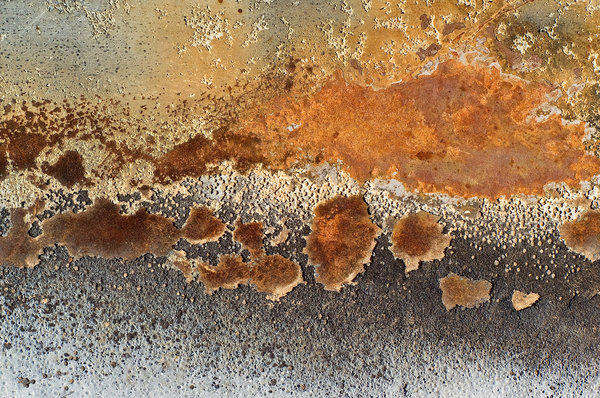 Steel, Paint and Fire: Details of burned paint on the hood (bonnet) of a car.