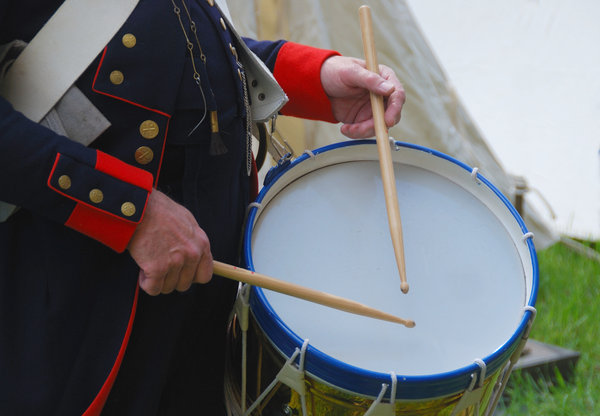 Drummer hands with sticks: Military drum from napoleonic times