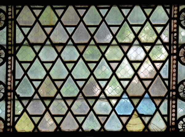 Medieval stained-glass texture: View trough medieval window with diamond form glasses