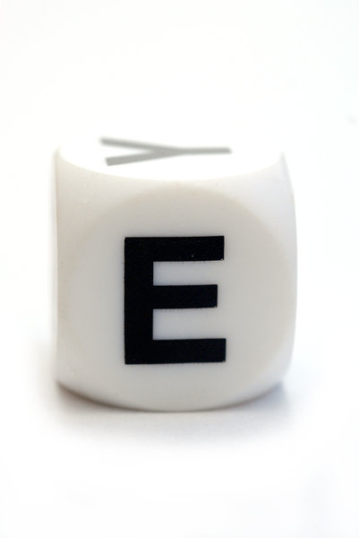 Character E on the cube: Dice with letter