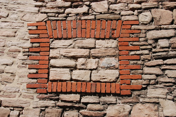 Old wall with blind window: Stone and brick wall texture