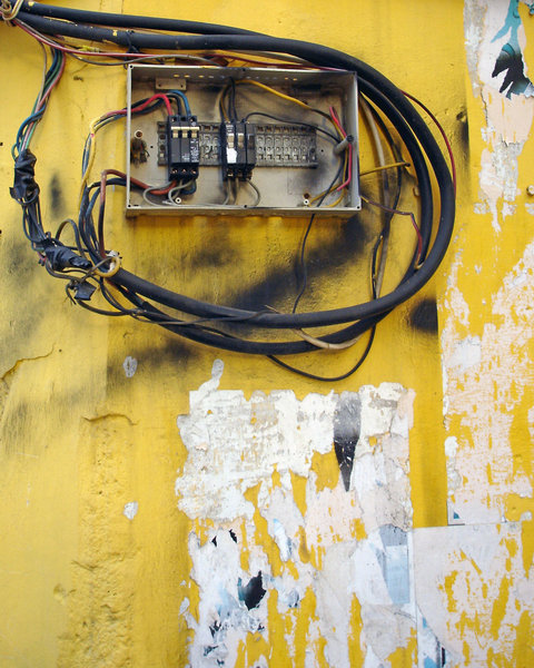 Fuse box: A fuse box on a wall.