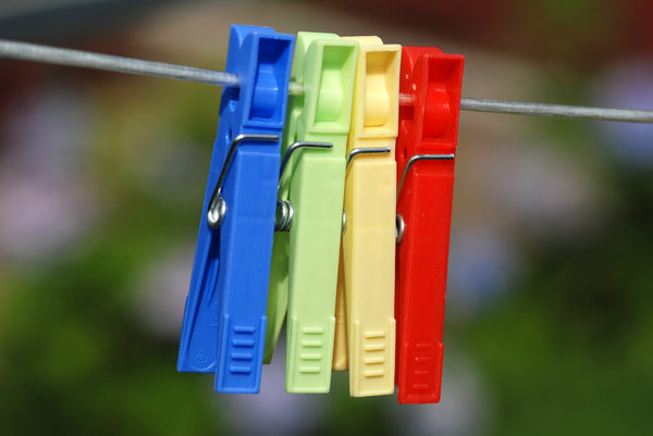 Clothes Pegs: Just a stock photo. A bunch of clothes pegs on wire.For single pegs, check:http://www.sxc.hu/photo/8 ..http://www.sxc.hu/photo/8 ..