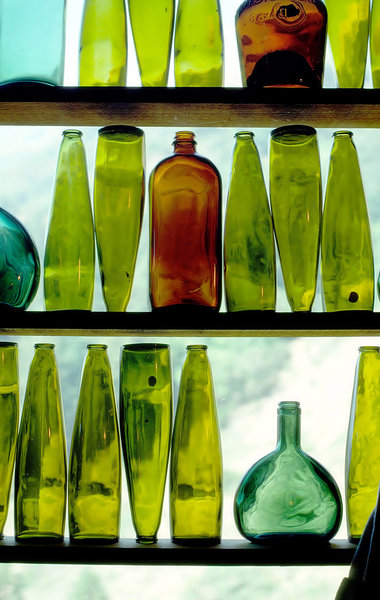 Wine Bottles in Window: Wine Bottles displayed in a restaurant in Big Sur, CA, USA