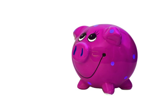 Pink Piggy Bank: A colourful, smiley piggy bank.  Lots of copy space.