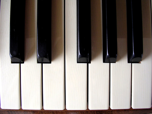 Piano Keys: Close up of a Piano's keys.This is a smaller version of the original which was uploaded to SXC about a year ago and had been downloaded 1130 times. The original has been moved to http://www.bigstockphoto. ..and can be bought for commercial use. The smalle