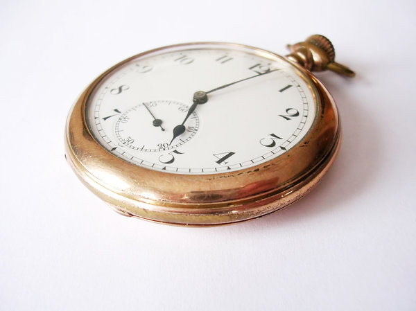 Pocket Watch 2: My great-grandfather's pocket watch. Different angles and different times shown. A side note: I had trouble getting a photo without my camera and fingers being reflected on the gold rim of the watch. If there's a better way to do this please let me know!