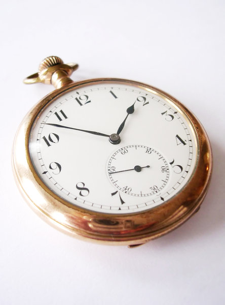 Pocket Watch 4: My great-grandfather's pocket watch. Different angles and different times shown. A side note: I had trouble getting a photo without my camera and fingers being reflected on the gold rim of the watch. If there's a better way to do this please let me know!
