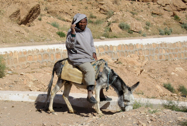 Farmer on donkey: A farmer in the Atlas mountains, Morocco