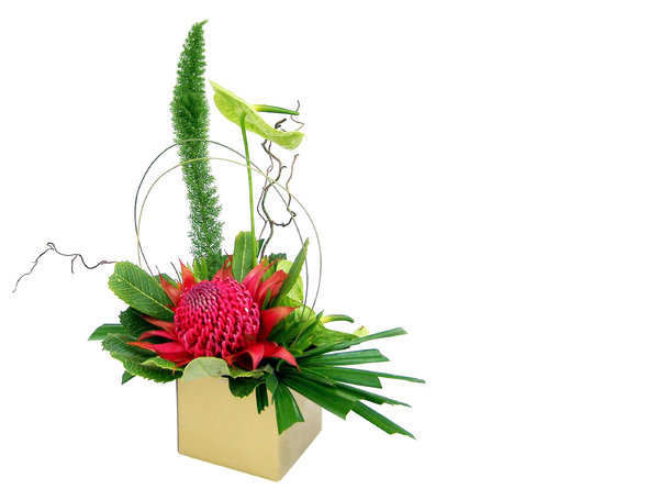 floral arrangement: table arrangement of foliage and flower.