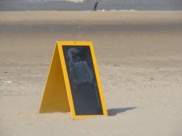 Sign at the beach: an empty sign at the dutch beach