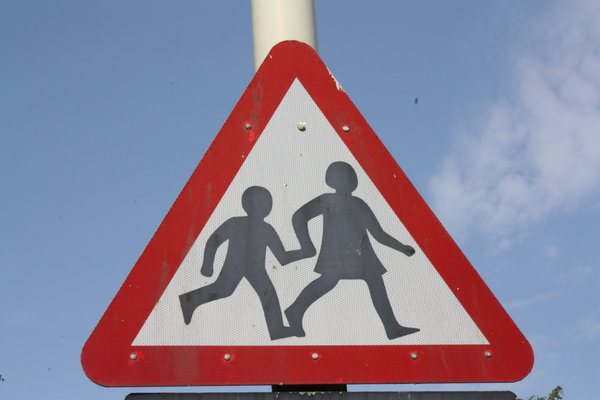 Children crossing 2: UK Warning sign for children cross a road