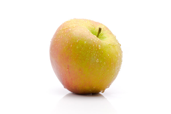 Apple: A wet apple isolated on white