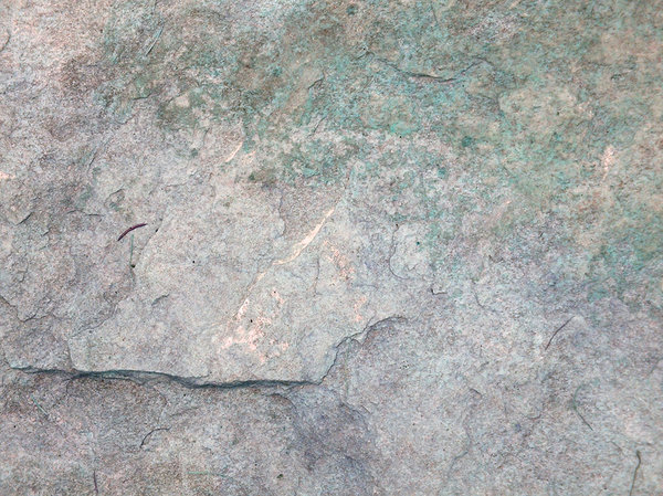 Stone texture: A mossed stone.