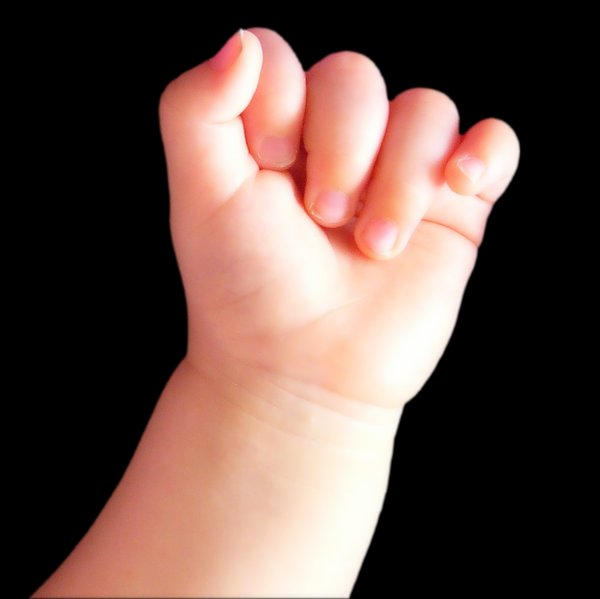 Baby's Hand: The hand of a sleeping 10 month old child.